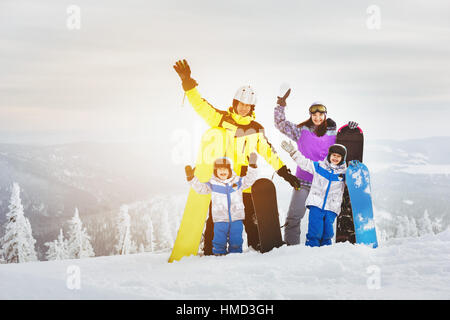 Happy family ski resort concept - Stock Image