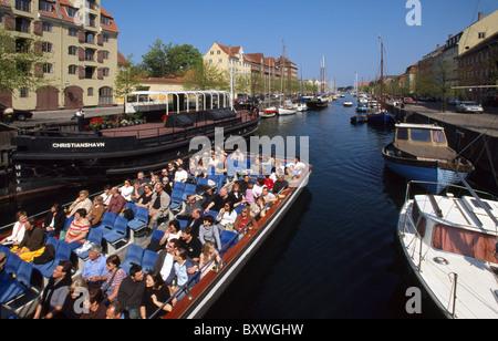 Boat with tourists, Christianshavn Canal, Copenhagen, Denmark - Stock Image
