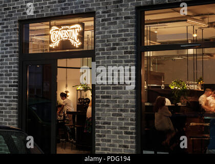 External outside view of chef Tom Brown's  Cornerstone restaurant bistro at Hackney Wick, East London, at night - Stock Image