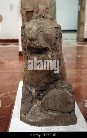 Lion holding a ram's head. Lebrija, Seville, Spain. Pre-roman peoples. Archaeological Museum of Seville. Spain. - Stock Image