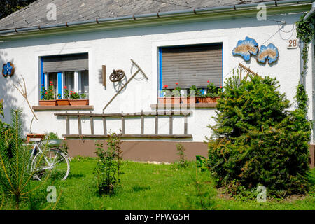 decorated house frontage in the small rural village of szatta vas county hungary - Stock Image