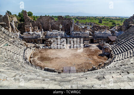 Old amphitheater from ancient times in the region of Antalya, Side, Turkey. - Stock Image