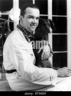 Rudolph Caracciola with his pet dog. - Stock Image