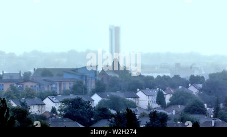 Glasgow, Scotland, UK 9th July, 2019. UK Weather:Heavy rain saw visibility decrease as mist hid the local landmarks behind a grey veil in the city known as Raintown in popular culture as Anniesland court tower the highest listed building in Scotland is left isolated showing the finger in the mist. Credit: Gerard Ferry/ Alamy Live News - Stock Image