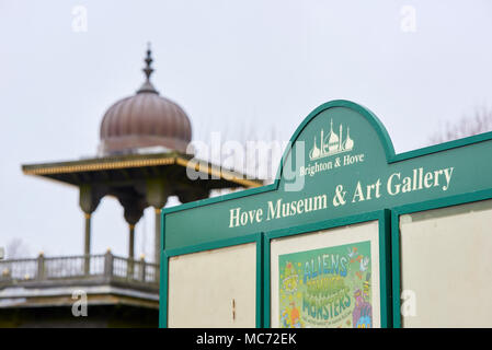 Detail of information board in front of Hove Museum and Art Gallery, with Jaipur Gate in the out-of-focus background. - Stock Image