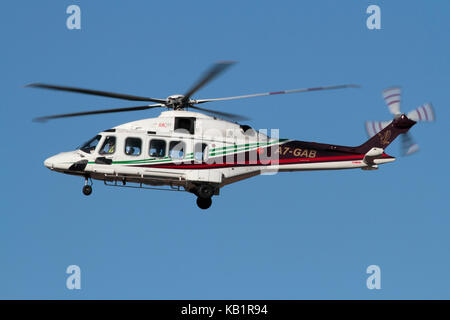 Transport by air. Gulf Helicopters AgustaWestland AW189 medium-lift helicopter on approach against a clear blue - Stock Image