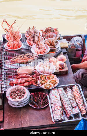 Barbecued seafood for sale at Amphawa floating market, Thailand - Stock Image