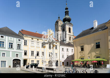 The historic centre of Stein an der Donau is a UNESCO world heritage site. The Dreifaltigkeitssäule, Frauenbergkirche and the Pfarrkirche - Stock Image