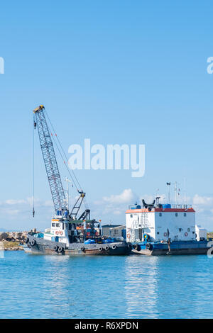 Tugboat and barge in the harbour in Varadero Cuba. - Stock Image