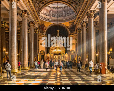 19 September 2018: St Petersburg, Russia - Interior of the Cathedral of Our Lady of Kazan with visitors. - Stock Image
