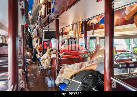 Onboard a Chinese intercity sleeper bus - Stock Image