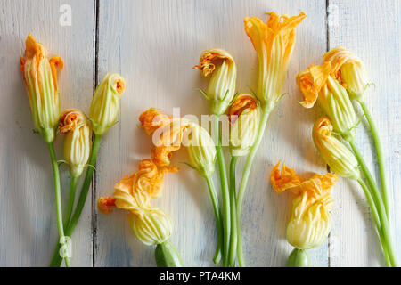 Courgette flowers on wooden background - Stock Image
