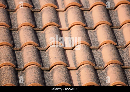 orange roof and blue sky background - Stock Image