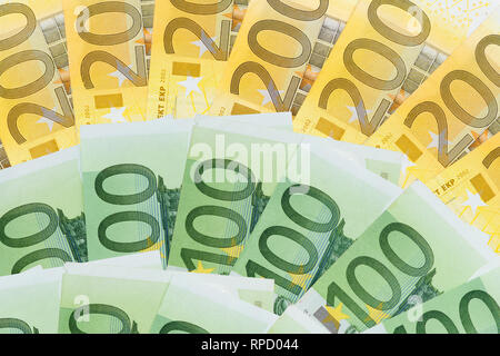 many one and two hundreds euros bank notes - Stock Image