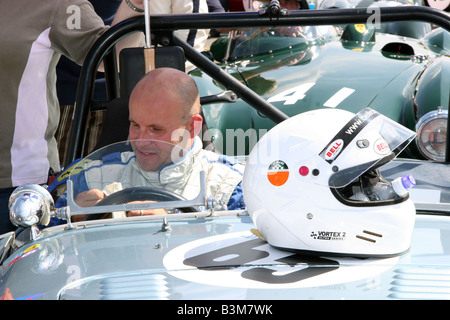 Racing driver in a classic racing car  hemet on bonnet in  the pit lane at Silverstone - Stock Image