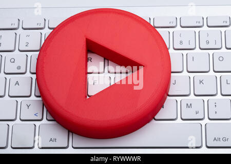 An Elevated View Of Red Play Button On White Keyboard - Stock Image