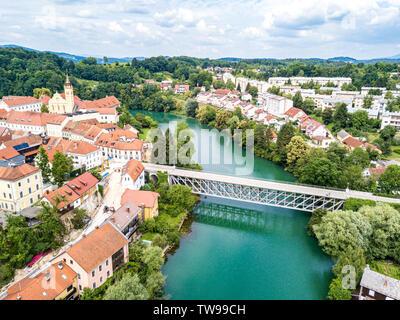 Aerial view of red roofs of Novo Mesto (previously Rudolfswerth, Newestat), Slovenia, Lower Carniola region, near Croatia. Historic Kandija iron bridg - Stock Image