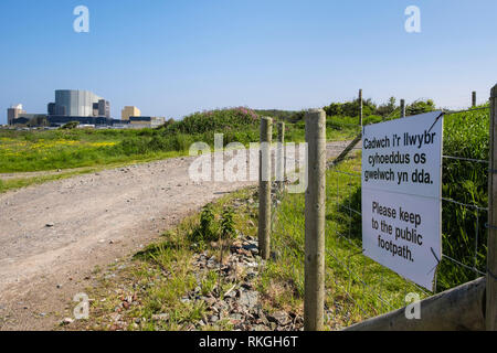 Bilingual sign on Isle of Anglesey Coastal Path re-routed around old Wylfa Nuclear Power Station for new Wylfa Newydd. Cemaes Anglesey Wales UK - Stock Image