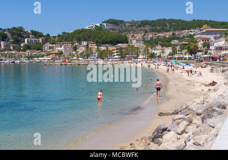 People enjoy the beach on a warm summer`s day in Port De Soller, Mallorca, Spain - Stock Image