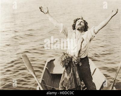 Man and child stranded at sea - Stock Image