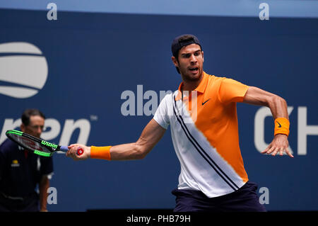 Flushing Meadows, New York - August 31, 2018: US Open Tennis:  Karen Khachanov of Russia returns a shot to Number 1 seed Rafael Nadal serving to his opponent  during their third round match at the US Open in Flushing Meadows, New York. Credit: Adam Stoltman/Alamy Live News - Stock Image