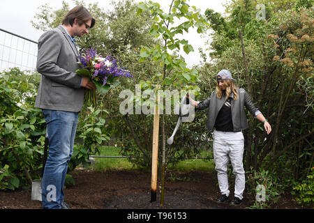 Prague, Czech Republic. 17th May, 2019. Czech snowboarder and alpine skier Ester Ledecka, right, plants a tree in Prague Botanical Garden within the project Roots of personalities, in Prague, Czech Republic, on May 17, 2019. On the left side is seen director of the garden Bohumil Cerny. Credit: Michal Kamaryt/CTK Photo/Alamy Live News - Stock Image