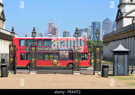 Red Double Decker bus passing the gate to Queen's House, Greenwich, England 180627_73623 - Stock Image