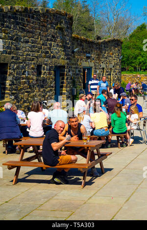 Family groups enjoying spring sunshine at the popular Lord Stones café in the Cleveland Hills North Yorkshire Moors National Park - Stock Image