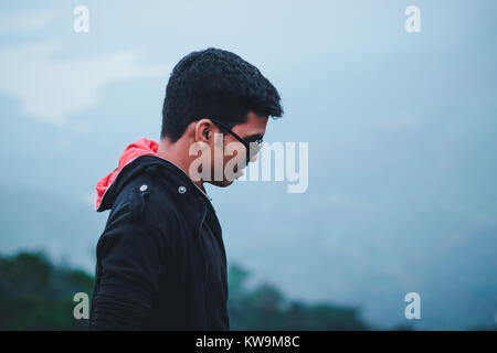 Casual male portrait representing traveling in the high mountains - Stock Image