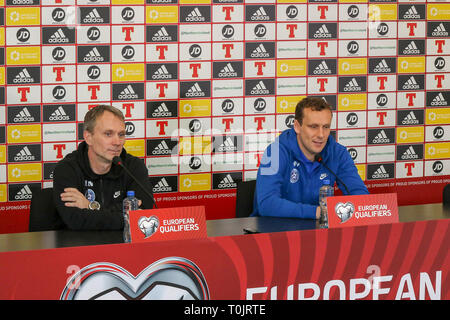 Windsor Park, Belfast, Northern Ireland, UK. 20 March 2019. The Estonian press-call before tomorrow night's Euro 2020 qualifying game in Belfast. Head coach Martin Reim (l) and Konstantin Vassiljev speaking at the press-call. Credit: David Hunter/Alamy Live News. - Stock Image