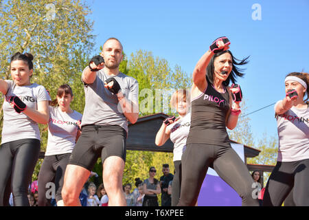Nis, Serbia - April 20, 2019 Young peoples group outdoor Piloxing gathering in park training with teacher on sunny day - Stock Image