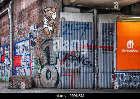 Mitte-Berlin. Railway viaduct with graffiti,street art, pipes and Lieferando advertisement - Stock Image