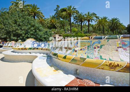 Ceramic benches designed by Antoni Gaudi at the Park Güell, Barcelona, Spain - Stock Image