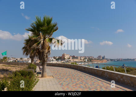 Mil Palmeras Costa Blanca Spain view from the paseo promenade to the beach and town with palm trees - Stock Image