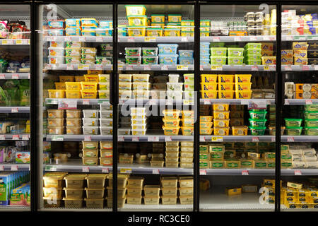 butter and margarine shelf in supermarket - Stock Image