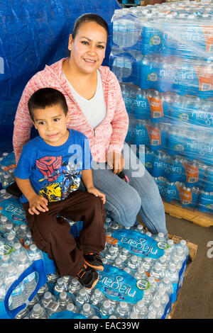 A water charity in Porterville supplying bottled water to houses who have had no running water for over five months, - Stock Image