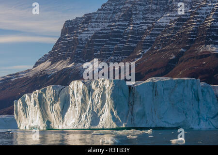 Greenland. Scoresby Sund. Gasefjord. Giant iceberg and mountains beyond. - Stock Image
