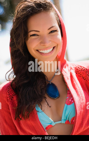 Portrait of a young woman smiling - Stock Image