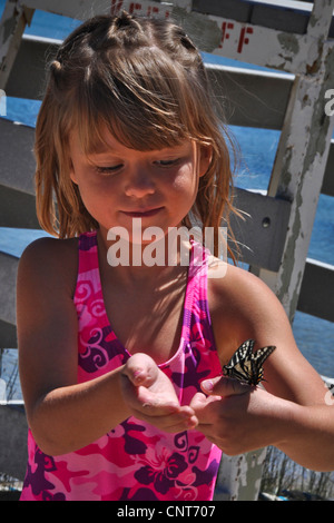 young happy girl butterfly nature fragile happiness wildlife cheerful - Stock Image