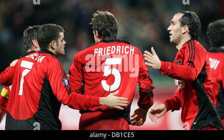 Leverkusen'S Tranquilo Barnetta (L) and Theofanis Gekas (R) cheer 1-0 scorer Manuel Friedrich (C) during the - Stock Image
