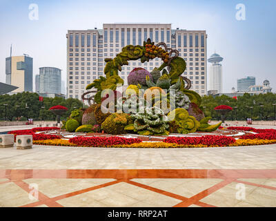 28 November 2018: Shanghai, China - Floral and topiary display in People's Square and the People's Government Building, Shanghai. - Stock Image