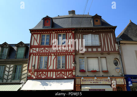 View of upper storey of half timbered buildings in Grande Rue des Stuarts, Dol de Bretagne, Ille et Vilaine, Brittany, France - Stock Image