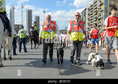 Police search dogs outside the stadium at the FA Cup Final 2017 Chelsea vs Arsenal in Wembley. London, UK - 27.05.2017. - Stock Image