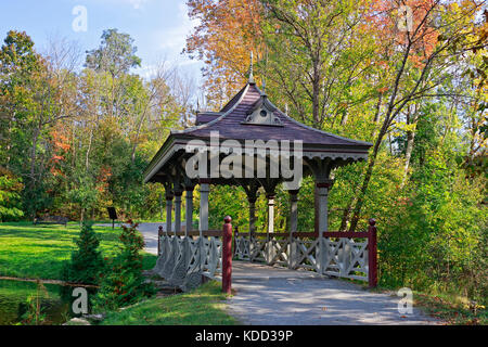 Peterborough covered Pagoda Bridge built  in 1894-1895, a Victorian style wood bridge over creek in picturesque - Stock Image