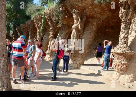 Barcelona, Spain, October 2018. People visiting Antoni Gaudi's Park Guell on a hot sunny morning. - Stock Image