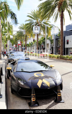 Batman decorated Lamborghini parked on Rodeo drive, Beverly Hills, Los Angeles, California. - Stock Image