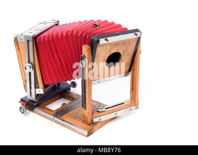 A folded Burke & Jame4x5 format flatbed view camera with red bellows. - Stock Image