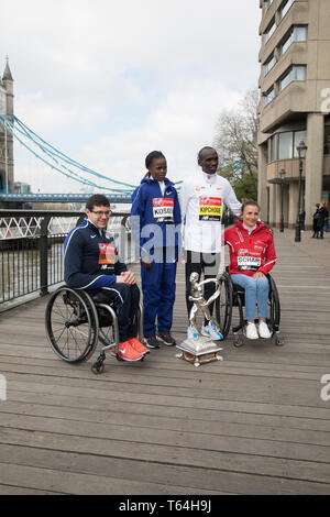 London,UK,29th April 2019,The London Marathon Winners photocall took place outside the Tower Hotel. Kenyans Eliud Kipchoge and Brigid Kosgei posed with Wheelchair athletes Manuela Schar(SUI) and Daniel Romanchuk(USA)Credit: Keith Larby/Alamy Live News - Stock Image