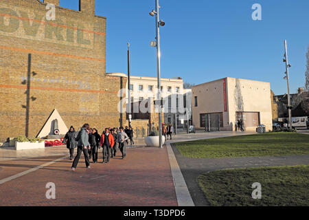 Group of schoolchildren outside the Black Cultural Archives entrance and Bovril building in Windrush Square Brixton South London SW2 UK  KATHY DEWITT - Stock Image
