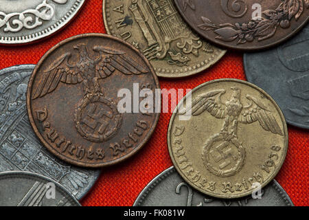 Coins of Nazi Germany. Nazi eagle atop swastika depicted in the German Reichsmark coins (1938). - Stock Image